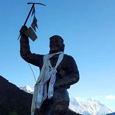 Morning sunrise with the statue of the most famous climbing sherpa of all time, Tenzing Norgay, with everest in the background.